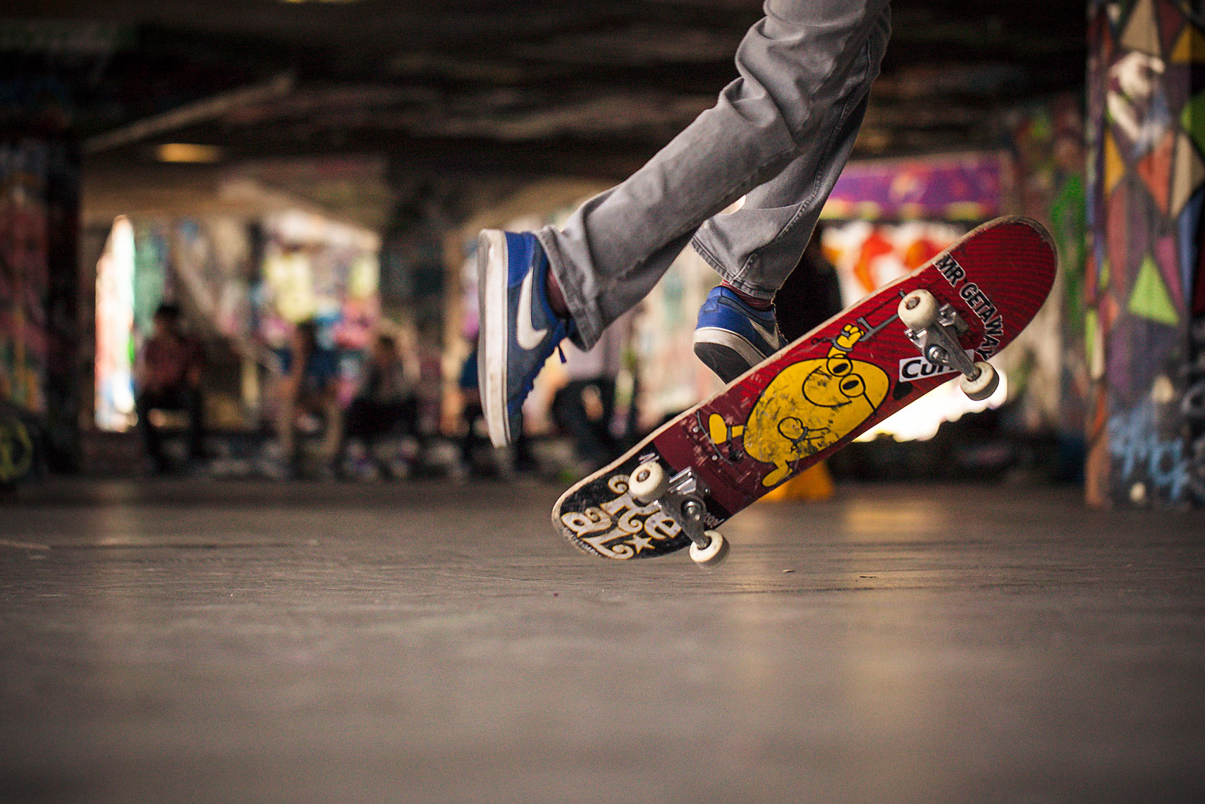 Young skateboarder in midair performing trick in central London.
