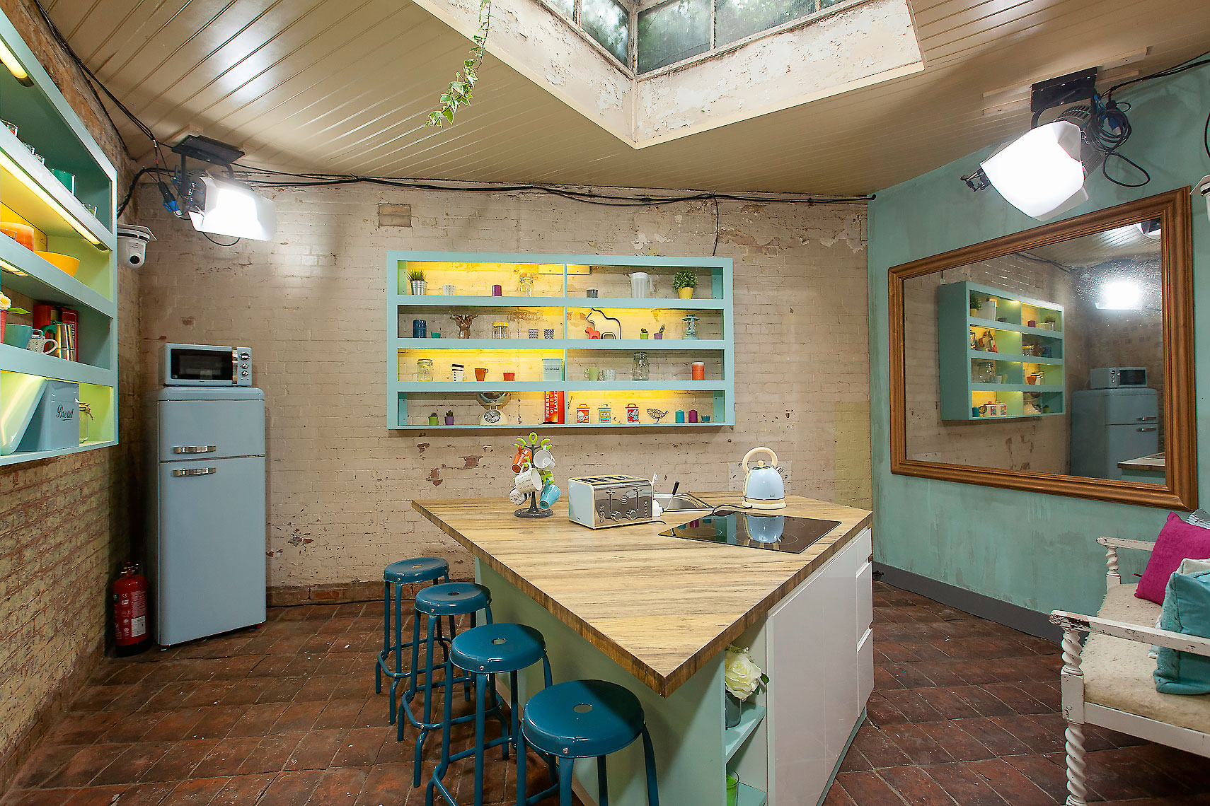 Television studio set of interior kitchen area with green walls and furnishings