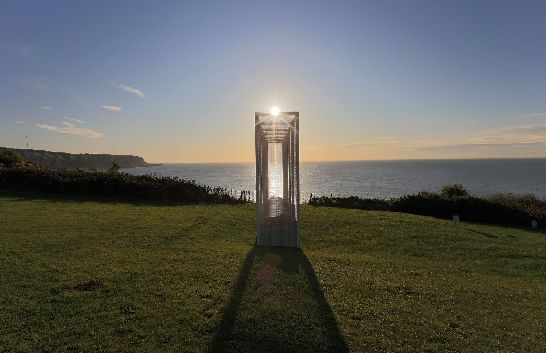 Sun rising over fine artwork next to the seaside in Folkestone, Kent UK