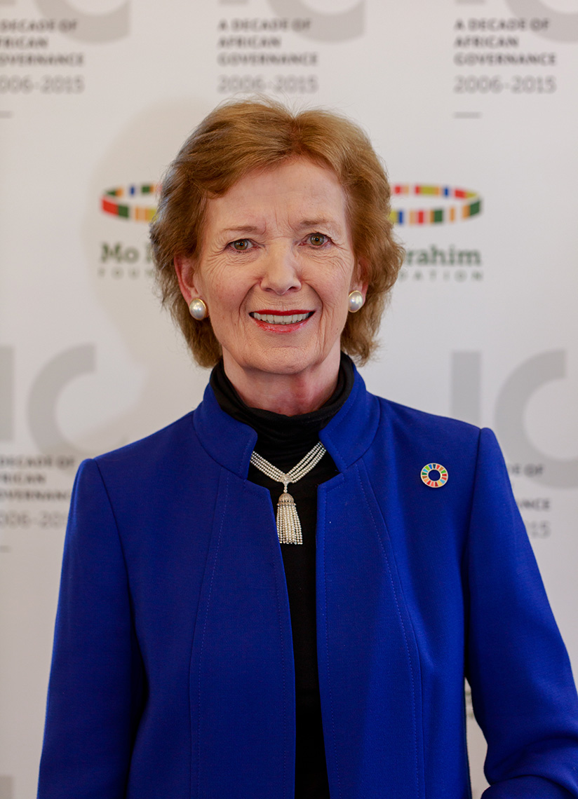 Former president of Scotland, Mary Robinson standing in blue coat wearing gold necklace