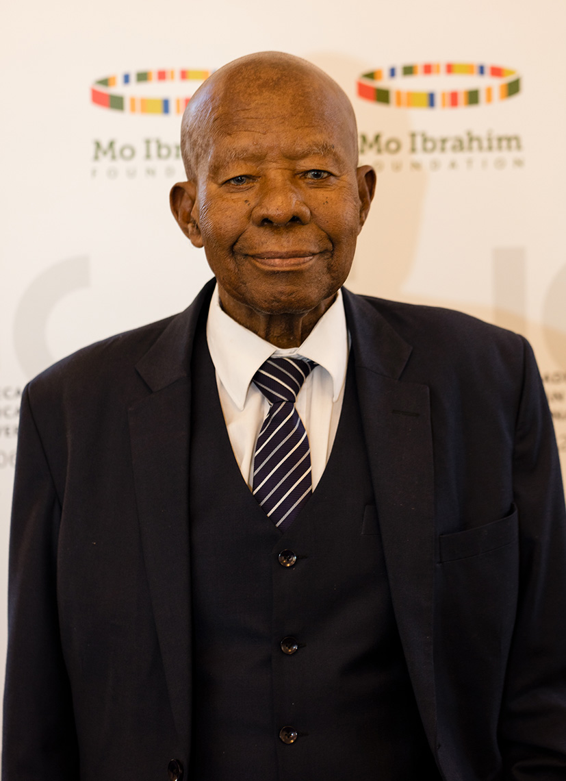 President Quett Ketumile Joni Masire wearing black suit and white shirt with dark coloured tie