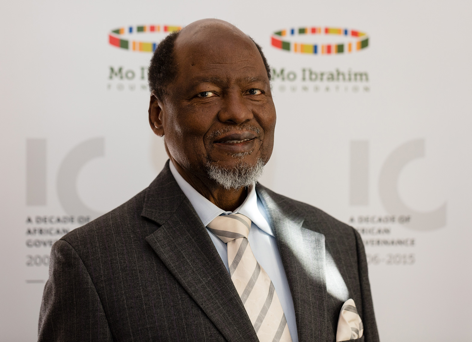 President Joaquim Chissano wearing grey suit and striped yellow tie
