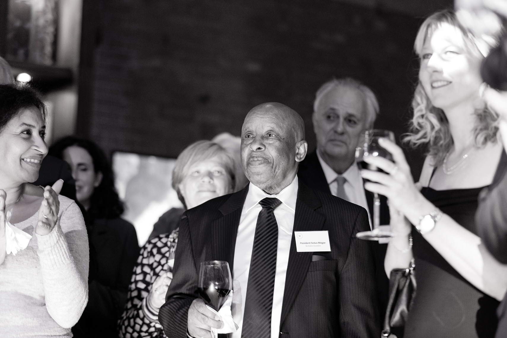 President Festus Mogae smiling and standing with a crowd watching the celebrations of a gala event in London