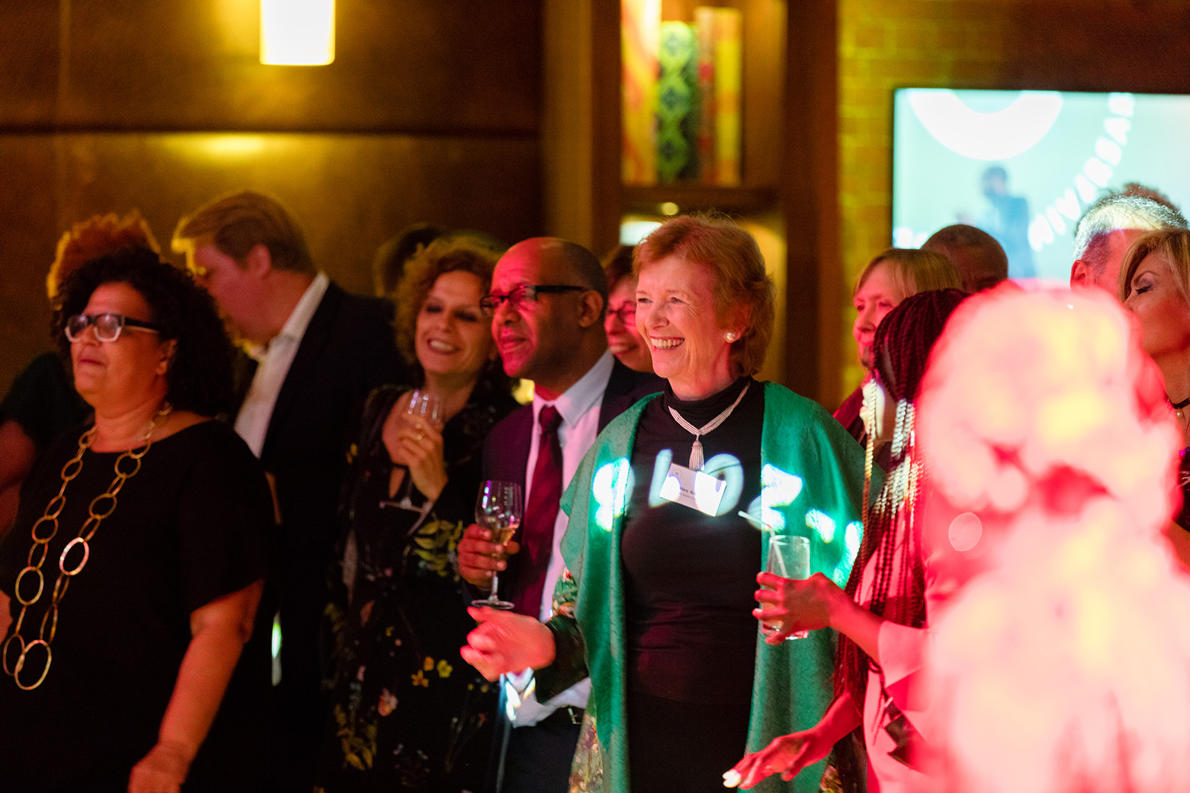 President Mary Robinson smiling and dancing at IIAG gala event in London
