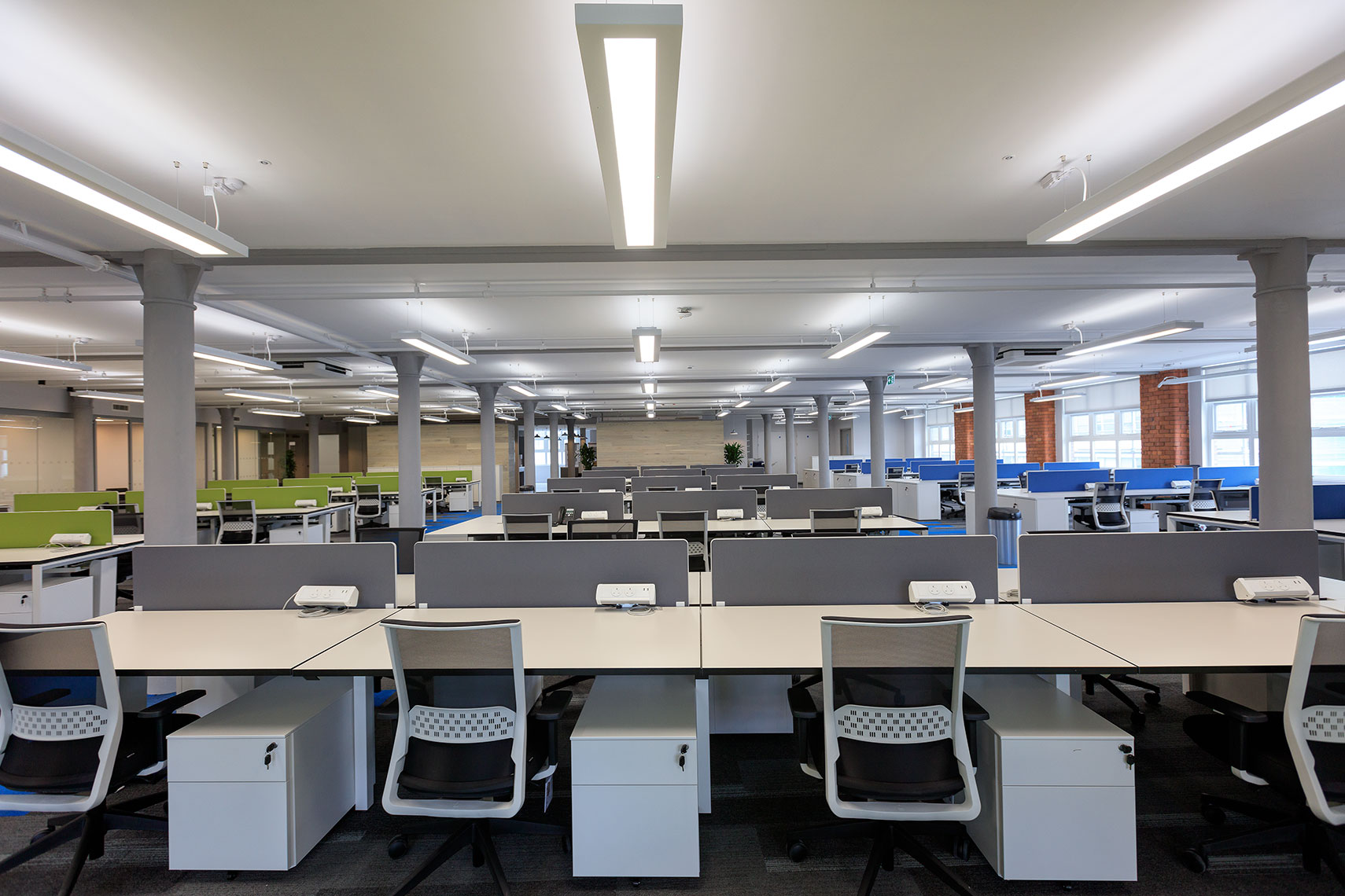 Interior fit-out architecture of open plan business offices in refurbished building in Manchester UK