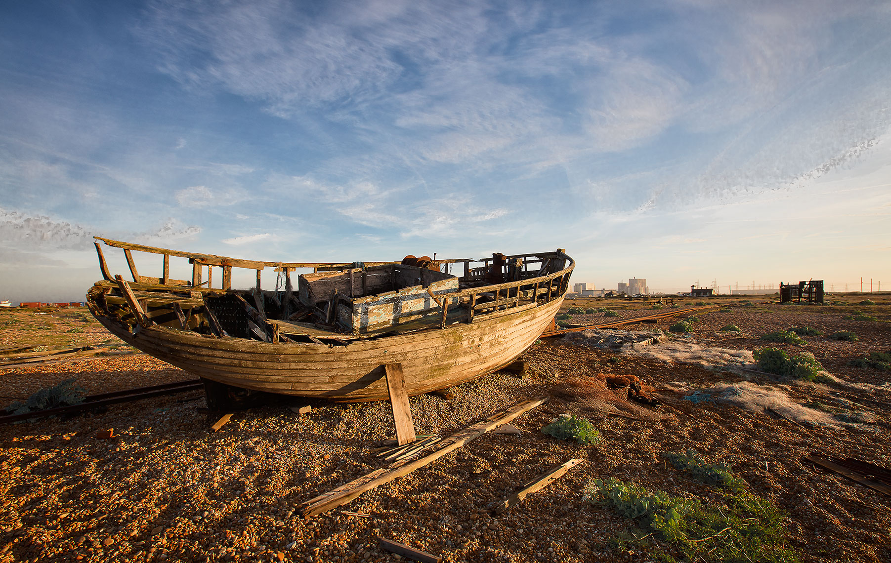 Old weathered ship with ageing wooden structure in desert environment