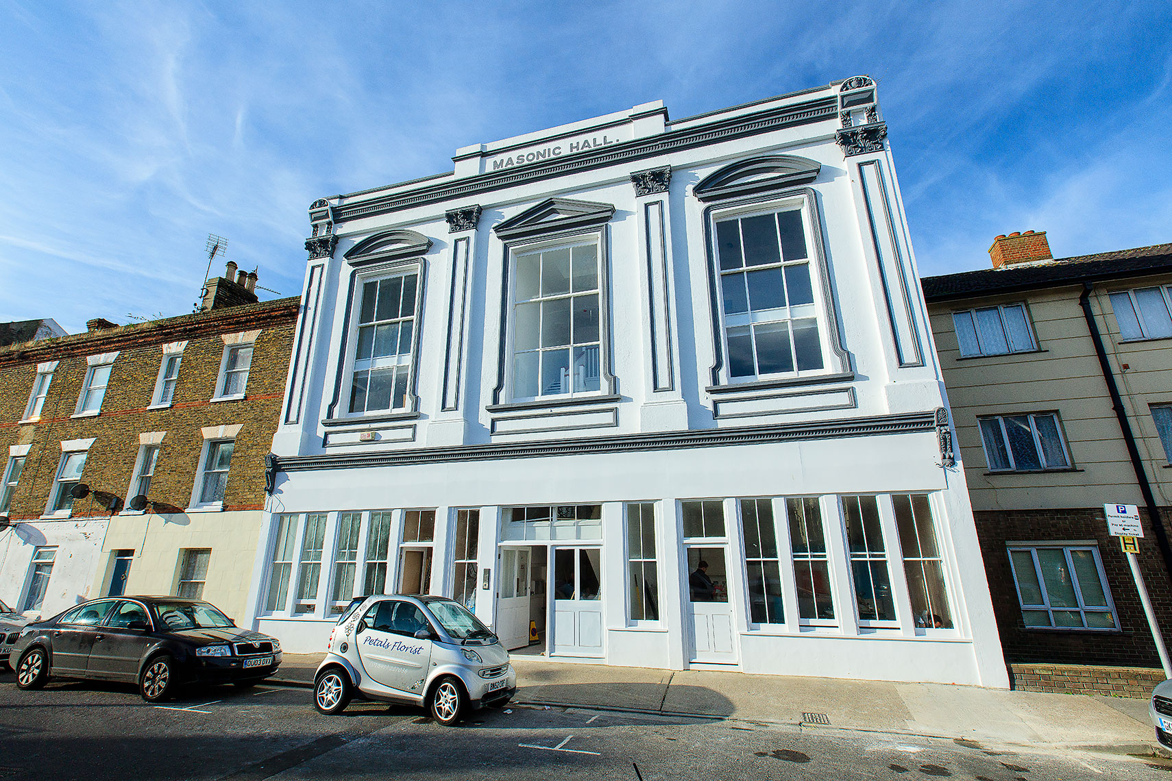Exterior architecture of white listed building with white pillars in Margate, Kent