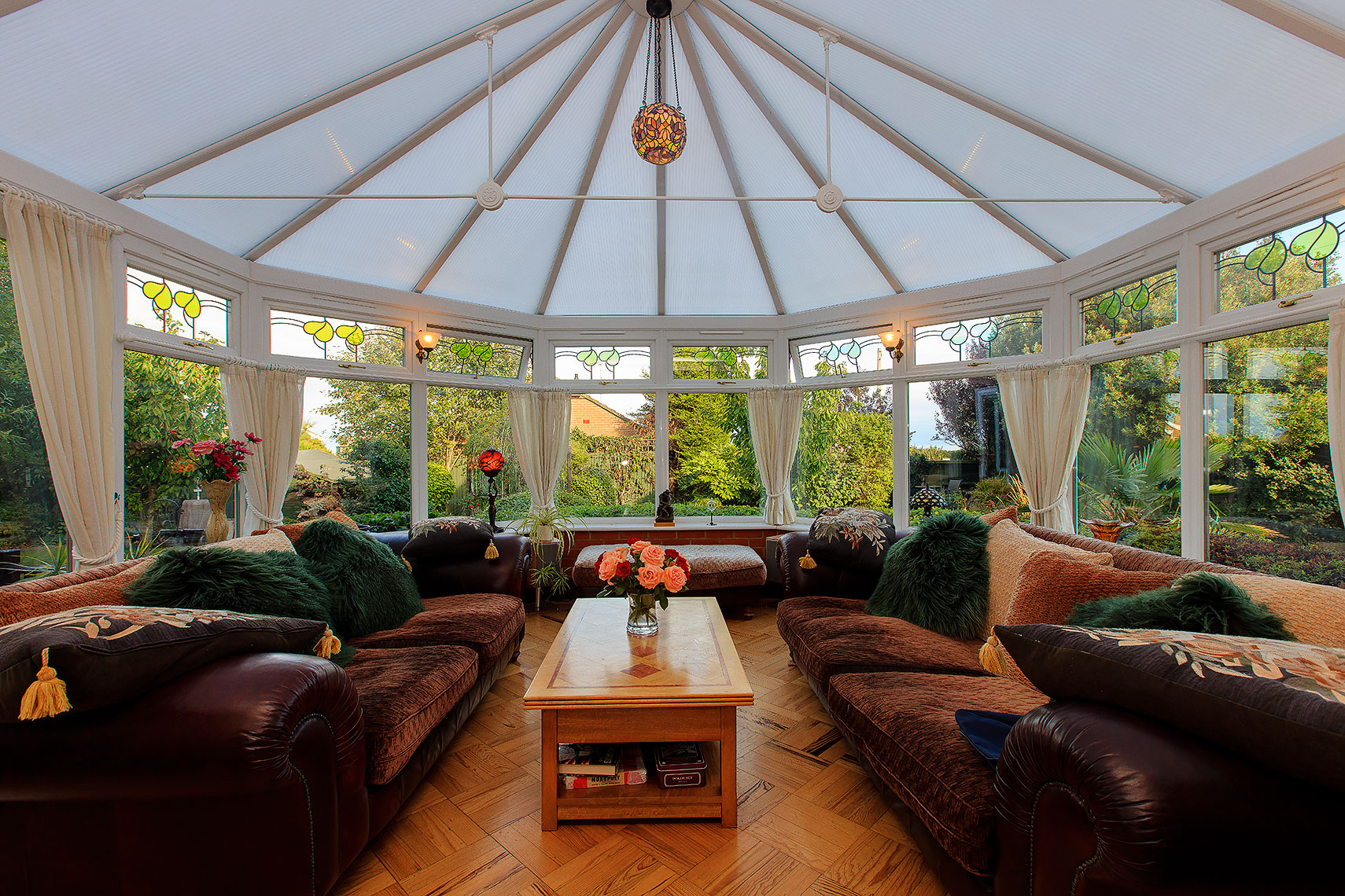 Glass lined interior conservatory architecture of residential property in Kent