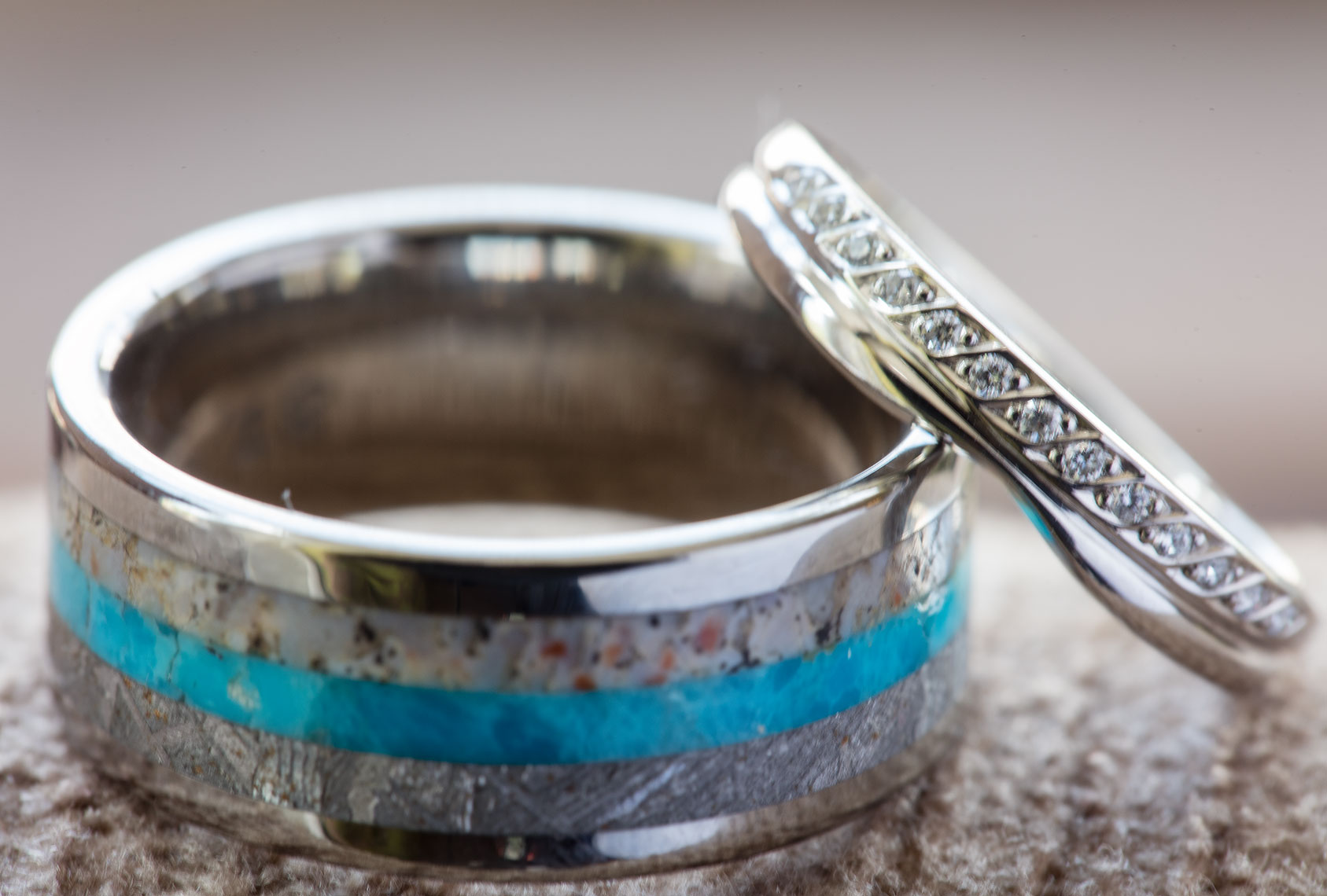Silver and turquoise wedding ring shimmering in window light