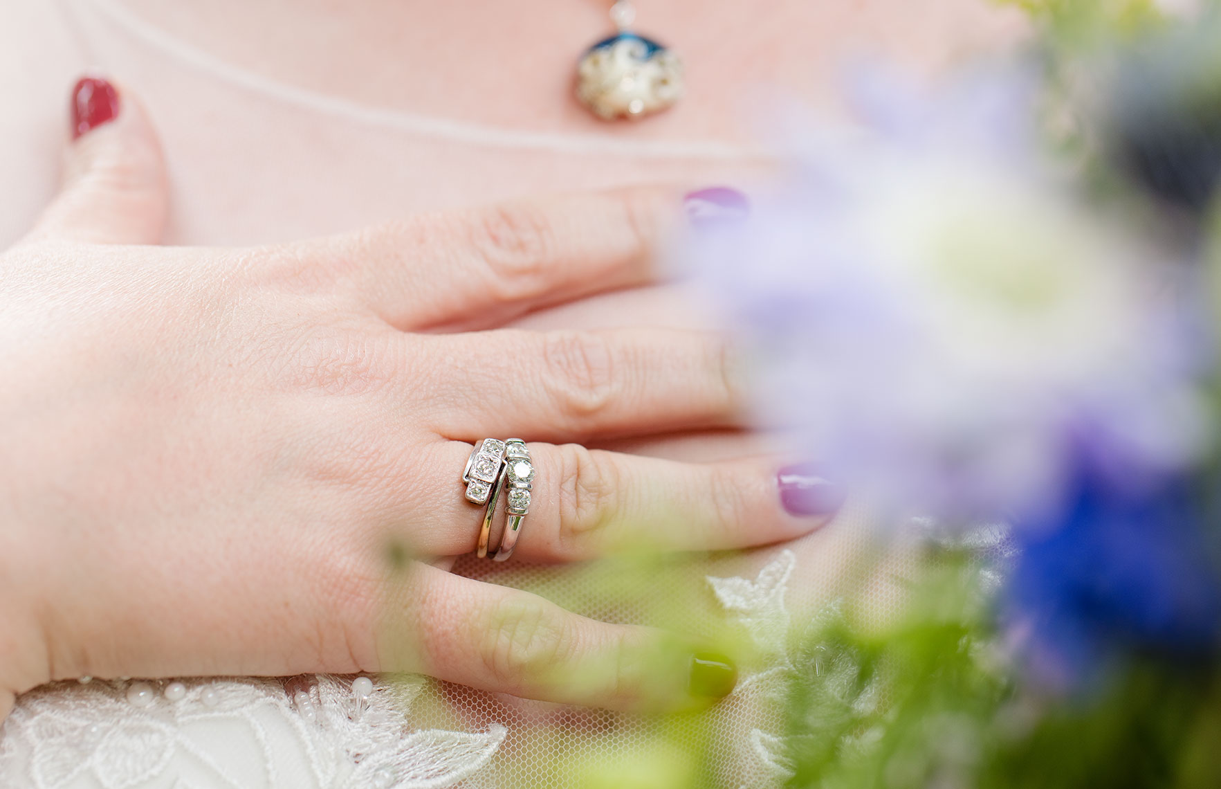Bride showing wedding ring in front of chest