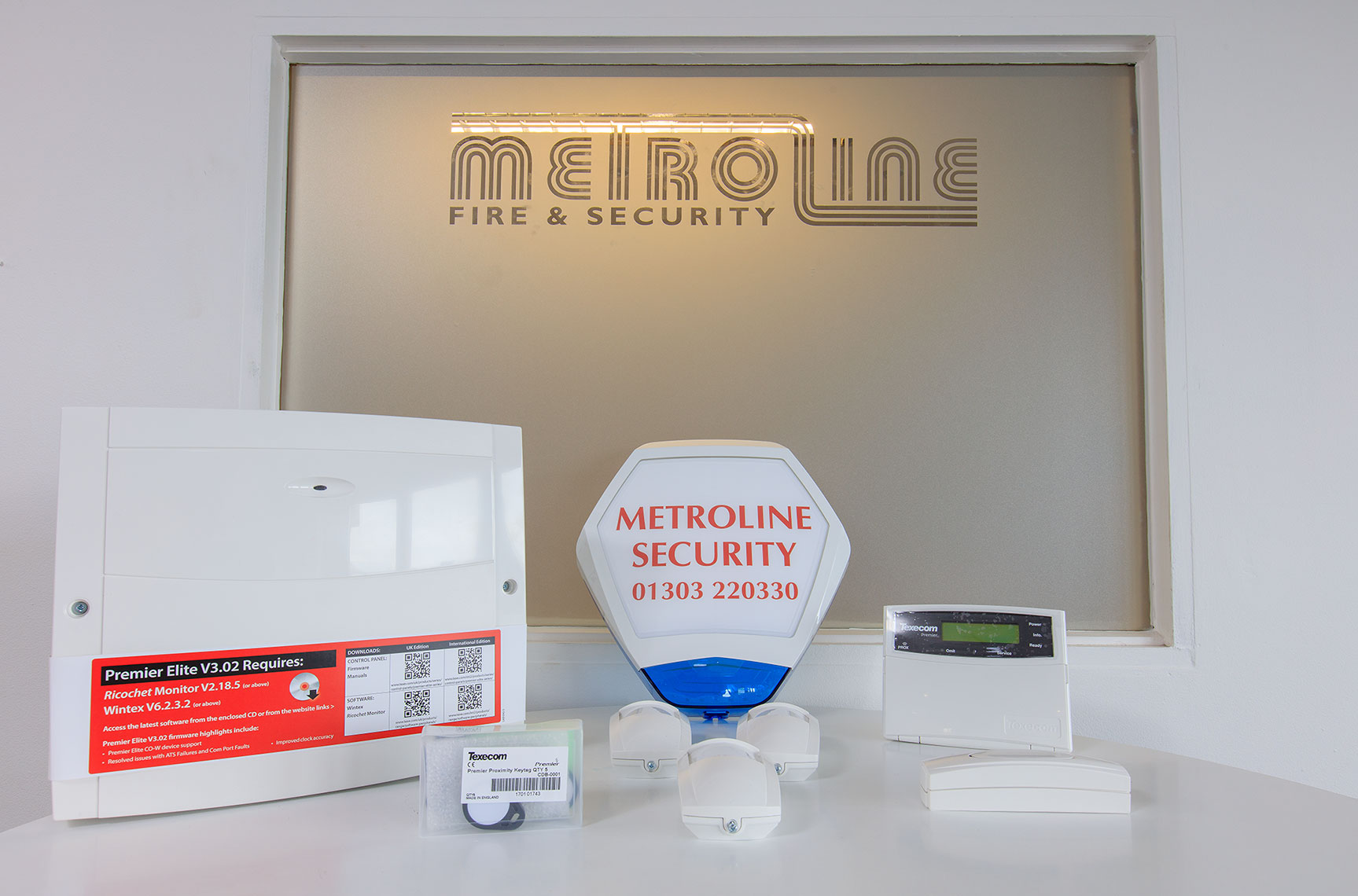 Security entrance system products displayed on table in company office