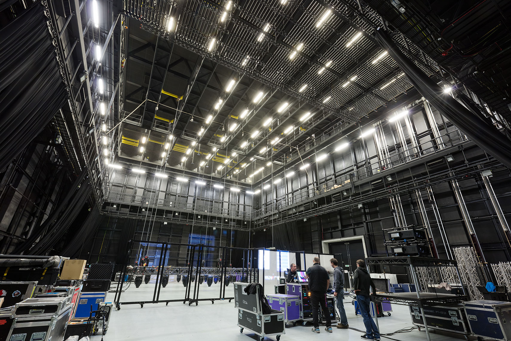 Television studio rehearsal space with technical equipment around the perimeter